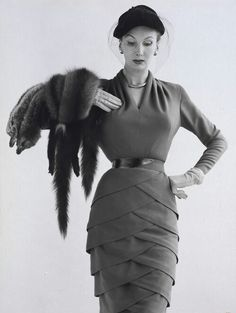 Dress by Lily Schroter Photograph of woollen day dress designed by Lily Schroter for Roter Models Ltd Modelled by Barbara Goalen Photographed by John French for Harvey Nicols' advertisement in Vogue England October 1951