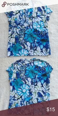 Chico's V- Neck Gently worn v- neck from Chico's. The colors are beautiful and the cut is very flattering. Chico's Tops Tees - Short Sleeve
