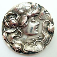 Elegant vintage Unger Art Nouveau sterling pin with a repousse of a woman's face. Dates between 1900-1910.