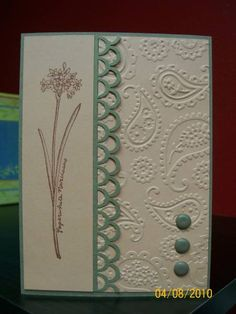 nice use of a loop punch and the paisley embossing folder