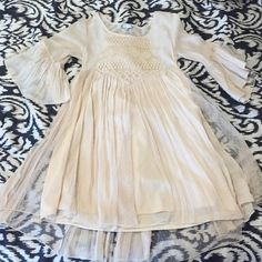 Festival dress Cream colored festival dress. Size medium. It is an above the knee dress. It has bell sleeves that are 3/4. Super cute with boots! Dresses Mini