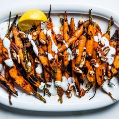 Parboiling the carrots before you grill them ensures they'll be tender without burning the sugars in the spice mixture, and primes them to absorb those flavors.