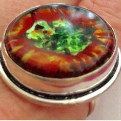💯% 925 silver ring SZ 9 💯% Murano glass orange ⛔️PRICE DROP⛔️polished dichroic Murano glass, round, with brighter colors than photoed of orangish,  yellow & bright, lime & dark green, inlayed into a 💯%925 Sterling silver setting. Size 9. Handmade, unique,mainstream style, NWOT, see earrings ( matching) 💥 will give great discount if bundling earrings with the ring 😘💕💙🎀 Handmade Jewelry Rings