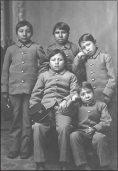 """A group of Sioux boys being """"civilized"""" at the Carlisle Indian School. (Library of Congress).In 1879, a U.S. military officer, Captain Richard Henry Pratt, opened a school for Indians in a military barracks in Carlisle,Pennsylvania. He believed that Indian people were capable of being transformed into the European American model of the law-abiding, Christian,wage-earning citizen.(pages 80-81)"""