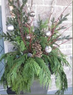 Greenery in a pot with Christmas Balls, window box, front porch, fresh greenery on bathroom counters