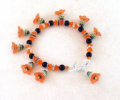 Halloween, Day of the Dead, Bracelet, Swarovski Crystal Beads, Orange Acrylic Flowers, Swarovski Pearls, Matching Earrings - pinned by pin4etsy.com