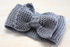 Warm up this winter with this adorable crochet headwarmer that is adorned with a big bow! Made with soft comfortable yarn, it is sure to keep you warm! Fits ages 4 years ~ Adult.