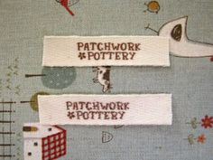 Haven't decided if I want tags or continue to use my embroidery machine to label my totes and purses.  Hmmmm.