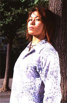 Semi-relaxed picture of Mariko Yoshida. She still looks like she might kill someone at any moment....