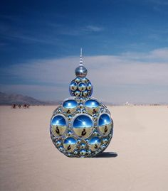 Kirsten Berg, Constellation of One is a 8 foot tall star tetrahedron structure that is covered in bubble shaped mirrors