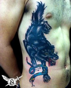 Snake Old School Side Wolf Tattoo by Ink and Dagger Tattoo
