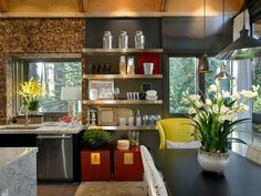 Fantastic colors and textures in this kitchen. Lime green, browns, greys, reds. Plants make all the difference, don't they?