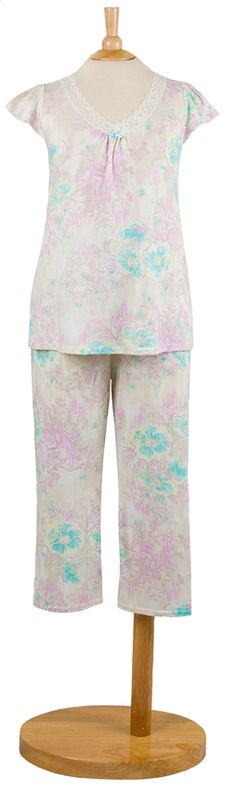 Miss Elaine® knit Pajama. Beautiful Lavender and Aqua Floral on Ivory ground. Short cap sleeves in a soft comfortable knit. Round neckline is triimmed with small tucks with lace eding the V-neckline. Capri pant with elasticized waist. Cotton/Polyester. Imported. $27.00