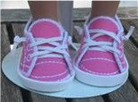 Shoes for 18 inch doll made in the hoop. This site has amazing machine embroidery clothes!