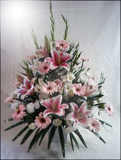 There are lines in this arrangement. The gladiolus create a vertical line. The green leaves create a vertical lines Funeral Floral Arrangements, Easter Flower Arrangements, Large Floral Arrangements, Beautiful Flower Arrangements, Floral Centerpieces, Beautiful Flowers, Alter Flowers, Church Flowers, Funeral Flowers