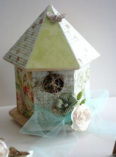 altered wood birdhouse and wrapped in tulle ribbon.