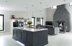An impressive view of the kitchen and sitting area.