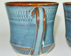 Hand thrown pottery mug, coffee cup, handmade pottery cup is hand thrown on a pottery wheel with blue and brown glazes. Price for one cup