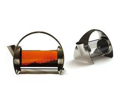 Sorapot is a unique, modern teapot. Its architectural shape and simple functionality bring tea's quiet beauty into sharp focus. Made from 304 stainless steel, borosilicate glass (Pyrex), and food-grade silicone.  Capacity: 11 oz, just enough for two cups of tea. Dimensions: 8″L x 6″H x 5″W