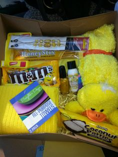 The box of sunshine I made for my mom it cost me probably $20 I got the box from work then I bought 2 bags of crumble shred as a box filler then I added a t shirt, 2 pairs of fuzzy socks, 2 towels, an eyeglass cord, some lip balm, nail polish, hand lotion, 2 kinds of candy, honey straws and a stuffed animal :) I also added a small smiley face balloon and a card
