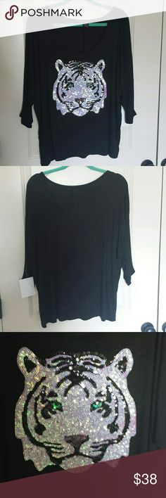 Tiger top Cute Black top with  Tiger print  sequins. Size L. Lose fit. Brand new with tags Tops