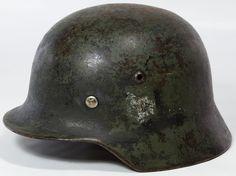 Lot 351: World War II German Army Helmet; Metal helmet and leather interior lining