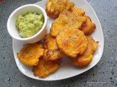 Tostones are green plantains, deep fried twice. They are popular in the Dominican Republic and Haiti, where obviously no-one cares about their arteries. They're also the closest I'm going to get to...