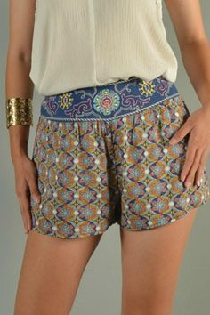 """High-waisted shorts featuring wide solid navy panel accented with colorful stitched embroidery design. Beautiful geometric star-flower print pattern on legs, front and back. Built-in comfy-fit stretch waistband on back only. Hem length is 13"""" from top of waist to bottom of hem at sides.   Star-Light Star-Bright  by Flying Tomato. Clothing - Shorts - Mini Clothing - Shorts - High-Waisted Clothing - Shorts Clothing - Shorts - Printed Fayetteville, Arkansas"""
