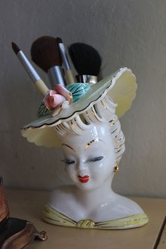 Cute idea for putting a lady head vase to everyday use