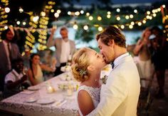 "The 10 Wedding ""Rules"" to Break - Couple kissing during wedding reception - Tom Merton/Caiaimage/Getty Images"