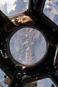 """The Earth view from the cupola  onboard the International Space Station. NASA astronaut Scott Kelly  tweeted this image with a comment on May 14, 2015: """"My first look out  the window today."""