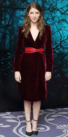 Anna Kendrick embraced the fairy tale theme with a rich ruby-red velvet wrap dress, with a cherry-red corseted belt and lace black ankle-strap Salvatore Ferragamo pumps. #InStyle