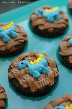 hand-piped dinosaur cupcakes