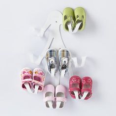 genius idea for storing shoes...I love her shoes and they'd make great wall art!