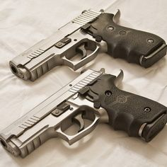 #Sig-Sauer #P229 Elite Stainless and a #P220 Carry Elite #Stainless with Hogue grips.