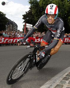 Radioshack-Nissan rider Cancellara of Switzerland cycles during the individual time trial in the first stage of the 99th Tour de France cycling race in Liege. BOGDAN CRISTEL/REUTERS