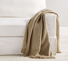 Just in time for sweater weather, our touchable and textured throws are what you'll want to grab when the air turns chilly. Woven of boucle yarns with softly heathered tones, it's trimmed with a little fringe detail for extra flair.  Woven of 75% acrylic and 25% polyester. Yarn-dyed for rich, lasting color. STANDARD 100 by OEKO-TEX(R) certified. Tested in an independent lab and verified to be safe from over 350 harmful substances. Machine wash. Imported. Sheepskin Throw, Boucle Yarn, Cashmere Throw, Lisa, Fall Capsule Wardrobe, Knitted Throws, Sweater Weather, Organic Cotton, Pottery Barn