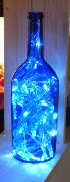 String Christmas lights inside an old wine bottle for pretty holiday decor