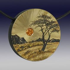 """Wolfgang Vaatz - Sugarman Peterson Gallery Gold and Silver 1.10"""" x 1.10"""" $1,350 Yellow Sapphire Hand Carved Pendant"""