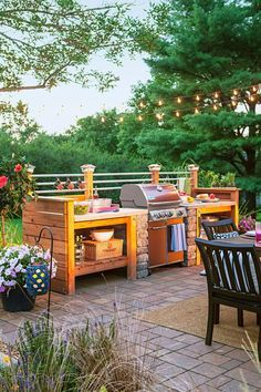 Build your own outdoor kitchen space from stacked stones and a DIY wood structure. This grill surround looks incredible and your neighbors will think so too.