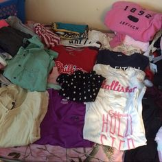 S XS 18 piece bundle All new condition! 18 items !All sizes small or XSMALL comes with tops , undershirts , a skirt , jacket &a hoodie! Also you get 3 free gifts! Hollister Tops