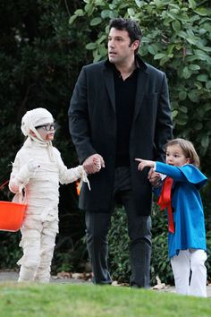 """Actors Ben Affleck and Jennifer Garner took their three children out to Trick or Treat in Los Angeles, California on October 31st. Unfortunately, Bennifer didn't dress up, but their kids costumes made up for it. We're assuming they're scouting out for the """"good houses"""" in the neighborhood with the good candy. I mean, that's what we do."""