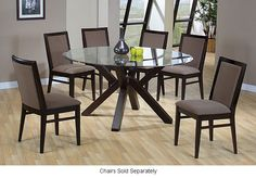This elegant glass top dining table features rubberwood legs, making it durable for years to come. The glass top gives an elegant look to any dining room and makes it suitable for many types of decor. Matching chairs are also available.