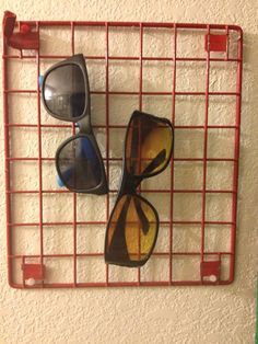 Sunglasses storage. A piece of a broken locker shelf as a hanger for sunglasses. By Mayra.