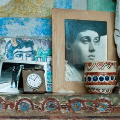 Charleston House Charleston studio mantelpiece detail including an portrait of a young Vanessa Bell by George Beresford. © Charleston Trust Photograph by Axel Hesslenberg