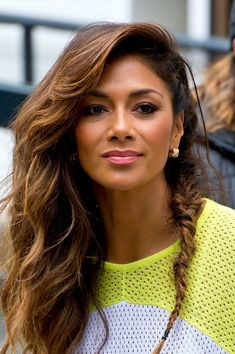 Nicole was seen in London wearing her hair in both beachy waves and a mini fishtail braid.