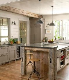 Rustic yet modern. Reclaimed wood beams in kitchen. Similar reclaimed wood available at www.icssdesign.com