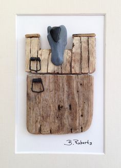 Horse looking out his stall driftwood pebble art. 5 1/2 x 7 1/2 black shadowbox frame and matted. Wonderful barn-like pieces of driftwood found on one of my beach walks. Great gift for the horse lover in your life... Or treat yourself