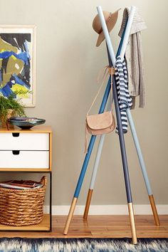 Wooden Dowel Coatrack by Emily HendersonTry subtle colorblocking on this coat rack, then leave it coat-free once spring really hits.