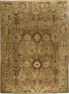 An antique Persian Sultanabad rug in muted shades of beige, brown with a touch of blue-grey. Sultanabad rugs are from an area in Iran where Ziegler & Co. of Manchester, England established a carpet workshop in the late 19th century adapting traditional Persian carpets for western taste.